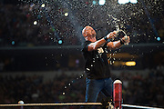 Stone Cold Steve Austin chugs beers during WrestleMania on April 3, 2016 in Arlington, Texas.