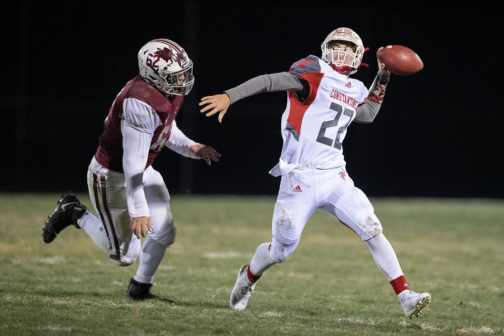 Constantine's Caden Hetzy passes the ball as Buchanan's Troy Holloway pursues during the Constantine-Buchanan high school football game on Friday, November 13, 2020, at Memorial Field in Buchanan, Michigan.