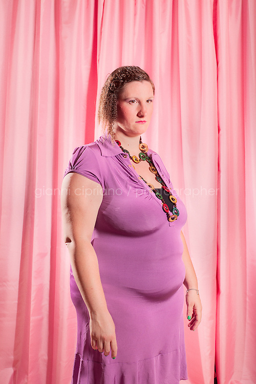"""FORCOLI, ITALY - 23 JULY, 2011: Veronica, 29, participates at Miss Cicciona (Miss Chubby), a pageant open only to women who weigh more than 220 pounds, in Forcoli, Italy. Miss Cicciona gives plus-size women, who could normally not eventer beauty pageants, an opportunity to take home a tiara. """"The competition aims to recognize and give light to the beauty and simple and true affection of women who usually ... are excluded from the spotlight,"""" wrote pageant founder Gianfranco Lazzereschi on the Miss Cicciona website."""