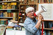 Brussels, Belgium 29 August 2014. Johan De Moor makes fun with a microphone.  He is a famous Belgian cartoonist and son of Bob De Moor, right hand of Tintin's Hergé, here in his studio. © Sander de Wilde pour M le magazine du Monde