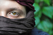 A portrait of a young middle eastern Man wearing a kaffiyeh Model Release Available