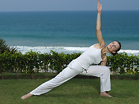 woman doing yoga exercise by the seaside