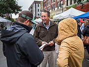 19 OCTOBER 2019 - DES MOINES, IOWA: MARK SANFORD (R-SC), center, talks to visitors to the Des Moines Farmers' Market during a campaign visit to the market Saturday. Sanford, a former Republican governor and Congressman from South Carolina, is challenging incumbent President Donald Trump for the Republican nomination for the US presidency. Iowa hosts the first event of the presidential selection cycle. The Iowa Caucuses are scheduled for February 3, 2020.               PHOTO BY JACK KURTZ