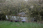 Boat abandoned in a hedge in Southam, England, United Kingdom.