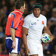 French Captain Thierry Dusautoir after scoring a try as referee Craig Joubert, South Africa, brushes past during the New Zealand V France Final at the IRB Rugby World Cup tournament, Eden Park, Auckland, New Zealand. 23rd October 2011. Photo Tim Clayton...
