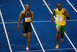 US Tyson Gay and Jamaica's Usain Bolt competes in the men's 100m final race of the 2009 IAAF Athletics World Championships ahead of US Tyson Gay and Jamaica's Asafa Powell on August 16, 2009 in Berlin. Jamaican Usain Bolt set a new world record of 9.58 seconds in winning the final of the men's 100m at the World Athletics Championships. His time bettered his own world record of 9.69sec set in the Beijing Olympics final. (Photo by Vid Ponikvar / Sportida)