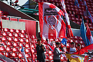 A Sunderland fan waves a giant flag before the EFL Sky Bet League 1 first leg Play Off match between Sunderland and Portsmouth at the Stadium Of Light, Sunderland, England on 11 May 2019.