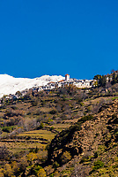 Capileira, Las Alpujarras, Granada Province, Andalusia, Spain. It is the second highest village in Spain. The Sierra Nevada Mountains are in the background.