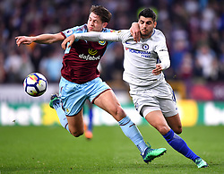 """Burnley's James Tarkowski (left) and Chelsea's Alvaro Morata (right) battle for the ball during the Premier League match at Turf Moor, Burnley. PRESS ASSOCIATION Photo. Picture date: Thursday April 19, 2018. See PA story SOCCER Burnley. Photo credit should read: Anthony Devlin/PA Wire. RESTRICTIONS: EDITORIAL USE ONLY No use with unauthorised audio, video, data, fixture lists, club/league logos or """"live"""" services. Online in-match use limited to 75 images, no video emulation. No use in betting, games or single club/league/player publications."""