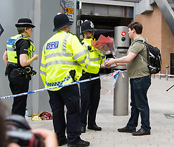 London, June 4th 2017. A man hands flowers to police officers during a massive policing operation in the aftermath of the terror attack on London Bridge and Borough Market on the night of June 3rd which left seven people dead and dozens injured