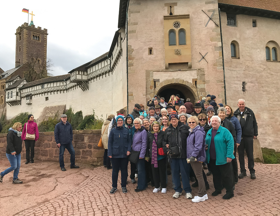 A portion of the tour group poses for a photo in front of Wartburg Castle in Eisenach, Germany. Martin Luther hid here while he translated the Bible into German.