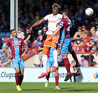 Blackpool's Armand Gnanduillet wins an aerial duel against Scunthorpe United's Rory McArdle<br /> <br /> Photographer David Shipman/CameraSport<br /> <br /> The EFL Sky Bet League One - Scunthorpe United v Blackpool - Friday 19th April 2019 - Glanford Park - Scunthorpe<br /> <br /> World Copyright © 2019 CameraSport. All rights reserved. 43 Linden Ave. Countesthorpe. Leicester. England. LE8 5PG - Tel: +44 (0) 116 277 4147 - admin@camerasport.com - www.camerasport.com