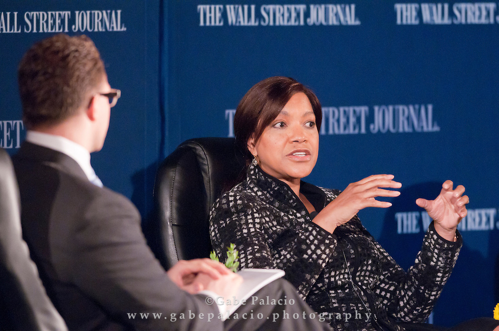 Grace Hightower De Niro, Board Member of New York Women's Foundation, speaks to Robert Frank, Senior Writer of the Wall Street Journal,  during The WSJ Future of New York series on Philanthropy in New York fin New York City on April 8, 2011.  (photo by Gabe Palacio)