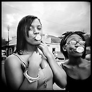 Kayla Gray and Tyanna Locke show off their bubble gum skills at the 2013 historic Mobile Street Renaissance Festival. Hattiesburg, Mississippi