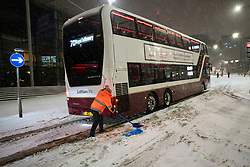 Edinburgh, Scotland, UK. 10 Feb 2021. Big freeze continues in the UK with heavy overnight and morning snow bringing traffic to a standstill on many roads in the city centre. Pic; Lothian buses become stuck on Leith Walk at 6am. Iain Masterton/Alamy Live news