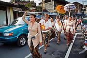 """Apr 24 - UBUD, BALI, INDONESIA: A religious procession on """"Monkey Forest Road"""" in Ubud, Bali. Photo by Jack Kurtz/ZUMA Press"""