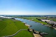 Nederland, Gelderland, Gemeente Lingewaard, 30-09-2015; industriegebied Looveer nabij Huissen aan de Nederrijn. Fabriek voor beton, betonmortel en prefabricated elementen. Veerpont.<br /> <br /> luchtfoto (toeslag op standard tarieven);<br /> aerial photo (additional fee required);<br /> copyright foto/photo Siebe Swart