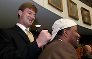 TALLAHASSEE, FL 3/13/03-Buc's quarterback Brad Johnson, left, signs the cap of Sen. Gary Siplin, D-Orlando, after a ceremony honoring their Super Bowl win Thursday at the Capitol in Tallahassee. COLIN HACKLEY PHOTO