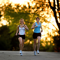 (SPORTS) Howell Twp 4/27/2006  Jessica (23) and Rebecca Clark (28) are sisters running together in the NJ Marathon in Long Branch this Sunday.   Here they are on a short run with the setting sun behind them.   Michael J. Treola Staff Photographer....MJT