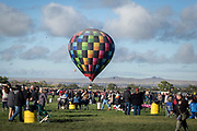 A balloon flies close to the ground at the AARP Block Party at the Albuquerque International Balloon Fiesta in Albuquerque New Mexico USA on Oct. 8th, 2018.