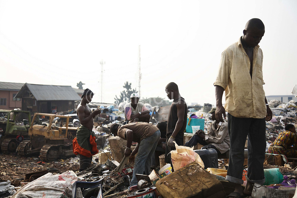 Olusosum dump site, Lagos.  Goverment run by the agency Lagos Waste Management Authority ( LAWMA ). One of 6 sites taking in general waste from all over Lagos.  E-waste is not allowed on site, but some does appear from the gerneral waste  collected all over Lagos.  Scavengers,- people, are making a living out of shifting through the rubbish and selling their collections for recycling.Some of the scavengers live on site, too poor to pay for accommodation any where else. This picture is part of an undercover investigation by Greenpeace and Sky News.  A TV-set originally delivered to a municipality-run collecting point in UK for discarded electronic products was tracked and monitored by Greenpeace using a combination of GPS, GSM, and an onboard radiofrequency transmitter placed inside the TV-set.  The TV arrived in Lagos in container no 4629416 and was found in Alaba International Market and bought back by Greenpeace activist. The TV was subsequently brought back to England and used as proof of illegal export of electronic waste. A number of individual are currently on trial in London in connection with illegal exports(Nov 2011)