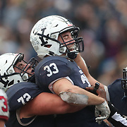 NEW HAVEN, CONNECTICUT - NOVEMBER 18: Zane Dudek #33 of Yale is congratulated by Dieter Eiselen #72 of Yale after scoring a touchdown during the Yale V Harvard, Ivy League Football match at the Yale Bowl. Yale won the game 24-3 to win their first outright league title since 1980. The game was the 134th meeting between Harvard and Yale, a historic rivalry that dates back to 1875. New Haven, Connecticut. 18th November 2017. (Photo by Tim Clayton/Corbis via Getty Images)