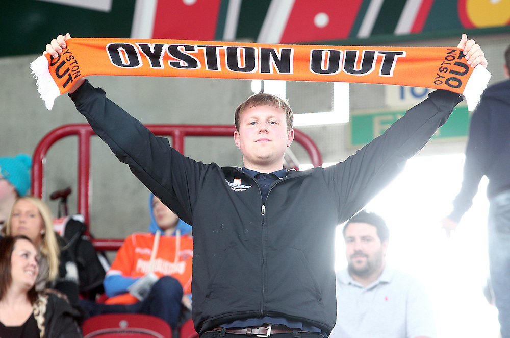 A Blackpool fan displays a 'Oyston Out' scarf before kick-off<br /> <br /> Photographer Rich Linley/CameraSport<br /> <br /> Football - The Football League Sky Bet Championship - Huddersfield Town v Blackpool  - Saturday 18th October 2014 - The John Smith's Stadium - Huddersfield<br /> <br /> © CameraSport - 43 Linden Ave. Countesthorpe. Leicester. England. LE8 5PG - Tel: +44 (0) 116 277 4147 - admin@camerasport.com - www.camerasport.com