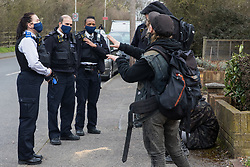 Sipson, UK. 8th March, 2021. Metropolitan Police officers use coronavirus legislation to ask residents evicted from the remaining section of a squatted off-grid eco-community garden known as Grow Heathrow to vacate the area. Grow Heathrow was founded in 2010 on a previously derelict site close to Heathrow airport in protest against government plans for a third runway and has since made a significant educational and spiritual contribution to life in the Heathrow villages which are threatened by airport expansion.