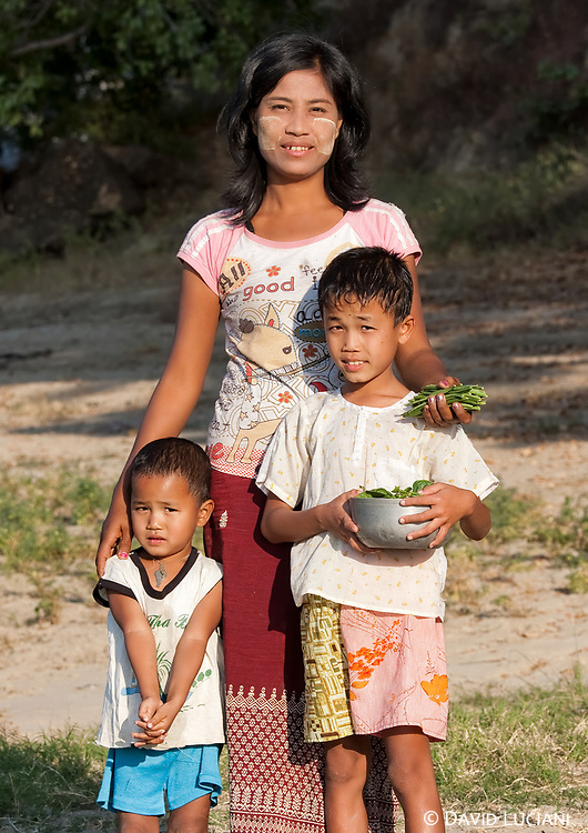 We met Kay Thi along the Irrawaddy riverbank while she was collecting beans, and her two sons were playing with a puppy dog. As i met her again the next day, i was invited to her home and introduced to her brother and her sister.