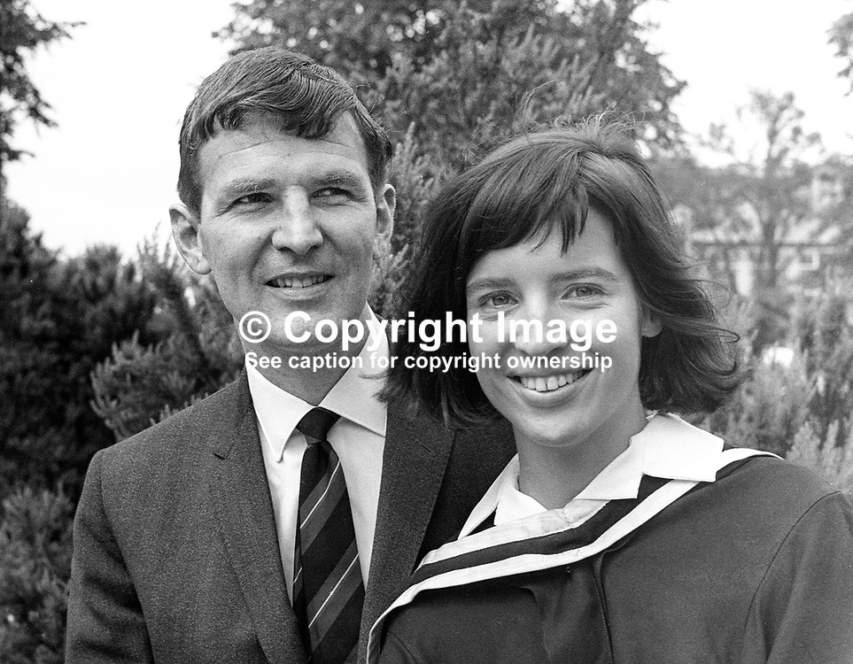 Barbara Kernohan, Belfast, who graduated in medicine from Queen's University Belfast, summer graduations, July 1967, pictured with her fiance & fellow medic, Dr Sydney Lowry. They married the day after Barbara's graduation. 196607000165b<br /> <br /> Copyright Image from Victor Patterson, Belfast, UK<br /> <br /> t: +44 28 9066 1296 (from Rep of Ireland 048 9066 1296)<br /> m: +44 7802 353836<br /> e: victorpattersonbelfast@gmail.com<br /> <br /> www.images4media.com<br /> <br /> Please see my full Terms and Conditions of Use at https://www.images4media.com/p/terms-conditions - it is IMPORTANT that you familiarise yourself with them.<br /> <br /> Images used online incur an additional cost. This cost should be agreed in writing in advance. Online images must be visibly watermarked i.e. © Victor Patterson or that of the named photographer within the body of the image. The original metadata must not be deleted from images used online.<br /> <br /> This image is only available for the use of the download recipient i.e. television station, newspaper, magazine, book publisher, etc, and must not be passed on to a third party. It is also downloaded on condition that each and every usage is notified within 7 days to victorpattersonbelfast@gmail.com.<br /> <br /> The right of Victor Patterson (or the named photographer) to be identified as the author is asserted in accordance with The Copyright Designs And Patents Act (1988). All moral rights are asserted.