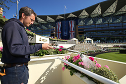 Flowers are watered in the grounds ahead of day four of Royal Ascot at Ascot Racecourse.