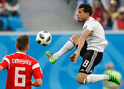 June 19, 2018 - Saint Petersburg, Russia - Tarek Hamed (R) of Egypt national team in action during the 2018 FIFA World Cup Russia group A match between Russia and Egypt on June 19, 2018 at Saint Petersburg Stadium in Saint Petersburg, Russia. (Credit Image: © Mike Kireev/NurPhoto via ZUMA Press)
