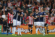 Andreas Bouhalakis of Nottingham Forest (2L) celebrates with teammates after scoring his team's first goal. EFL Skybet football league championship match, Brentford  v Nottingham Forest at Griffin Park in London on Saturday 12th August 2017.<br /> pic by Steffan Bowen, Andrew Orchard sports photography.