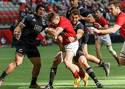 March 10, 2018 - Vancouver, British Columbia, U.S. - VANCOUVER, BC - MARCH 10: Scotland ball carrier tackled by Kurt Baker (#10) of New Zealand during Game # 1- New Zealand vs Scotland Pool D match at the Canada Sevens held March 10-11, 2018 in BC Place Stadium in Vancouver, BC. (Photo by Allan Hamilton/Icon Sportswire) (Credit Image: © Allan Hamilton/Icon SMI via ZUMA Press)