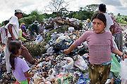 09 NOVEMBER 2004 - TAPACHULA, CHIAPAS, MEXICO: People pick through the garbage in the municipal garbage dump in Tapachula, Chiapas, Mexico. About 130 people, the poorest of the poor in Tapachula, work in the dump picking through the garbage hoping to find tidbits they can use or sell to brokers who sit on the edge of the dump and resell the garbage. Most of the dump workers are Guatemalan migrants who crossed the border hoping, at one time, to get to the United States. Now they have settled for an existence on the very edge of Mexican society. PHOTO BY JACK KURTZ