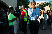 Dominique R. Alexander, president and founder of Next Generation Action Network, speaks during a protest at Joyce Kelly Comstock Elementary School in response to an incident with teens and police officers at a community pool in McKinney, Texas on June 8, 2015.  (Cooper Neill for The New York Times)