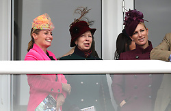Dolly Maude, The Princess Royal and Zara Tindall watch the race action during Ladies Day of the 2019 Cheltenham Festival at Cheltenham Racecourse.