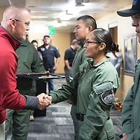 Lieutenant Padovich shakes the hand of officer Nicole Diswood, the first female Emergency Response Team (ERT) member for the Gallup Police Department, Tuesday, Oct. 30, at a cermony for completing the Gallup Police Emergency Response Training swat course.