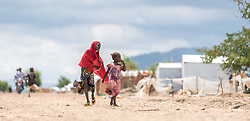 30 May 2019, Mokolo, Cameroon: Two young girls walk through the Minawao camp. The Minawao camp for Nigerian refugees, located in the Far North region of Cameroon, hosts some 58,000 refugees from North East Nigeria. The refugees are supported by the Lutheran World Federation, together with a range of partners.
