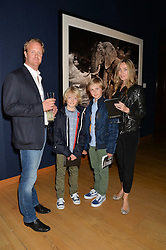 ROB & NIKKI DRAKE-BROCKMAN and their sons SEBASTIAN & HARRY at the Christie's Conservation Lectures in aid of Tusk held atChristie's, 8 King Street, London on 30th April 2014.