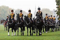 © Licensed to London News Pictures. 19/10/2017. London, UK. The King's Troop Royal Horse Artillery parade in front of Queen Elizabeth II in Hyde Park, on the occasion of their 70th Anniversary. The KTRHA was formed on the wishes of His Majesty King George VI in October 1947. Commonly known as the 'Gunners', The Royal Artillery provides firepower to the British Army. Equipped with 13-pounder field guns dating from WWI, the Troop provides ceremonial salutes for Royal occasions and state functions. Photo credit: Ray Tang/LNP