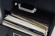 documents inside metal filing cabinet