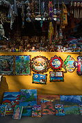 View of a market stall with lots of antiques, religious objects, figurines, paintings and souvenirs, Leon, Nicaragua