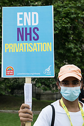 A man holding a Unite End NHS Privatisation placard prepares to march with NHS workers from the grassroots NHSPay15 campaign from Parliament to 10 Downing Street with a petition signed by over 800,000 people calling for a 15% pay rise for NHS workers on 20th July 2021 in London, United Kingdom. At the time of presentation of the petition, the government was believed to be preparing to offer NHS workers a 3% pay rise in 'recognition of the unique impact of the pandemic on the NHS'.