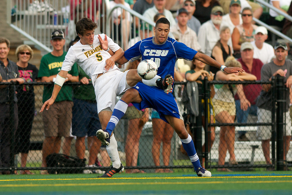 Catamounts midfielder Charlie DeFeo (5) fights for the ball during the men's soccer game between the Central Connecticut State University Blue Devils and the Vermont Catamounts at Virtue Field on Friday afternoon September 7, 2012 in Burlington, Vermont.