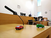 Empty Israeli traffic court as seen from the witness stand with toy cars to help the witness explain and demonstrate