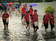 Heavy rain quickly floods the streets in Bangkok, Thailand