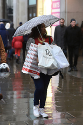 Shoppers during 'Panic Saturday' rush around to do Christmas Shopping on the last Saturday before Christmas on Oxford Street and the surrounding areas.<br /> Saturday, 21st December 2013. Picture by Ben Stevens / i-Images