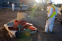 A Salinas city worker with some of the bedding used at a homeless encampment on Soledad Street. On Thursday, January 31st, workers, health officials and police conducted an early morning sweep of Chinatown, removing camps on the street and in lots between buildings.
