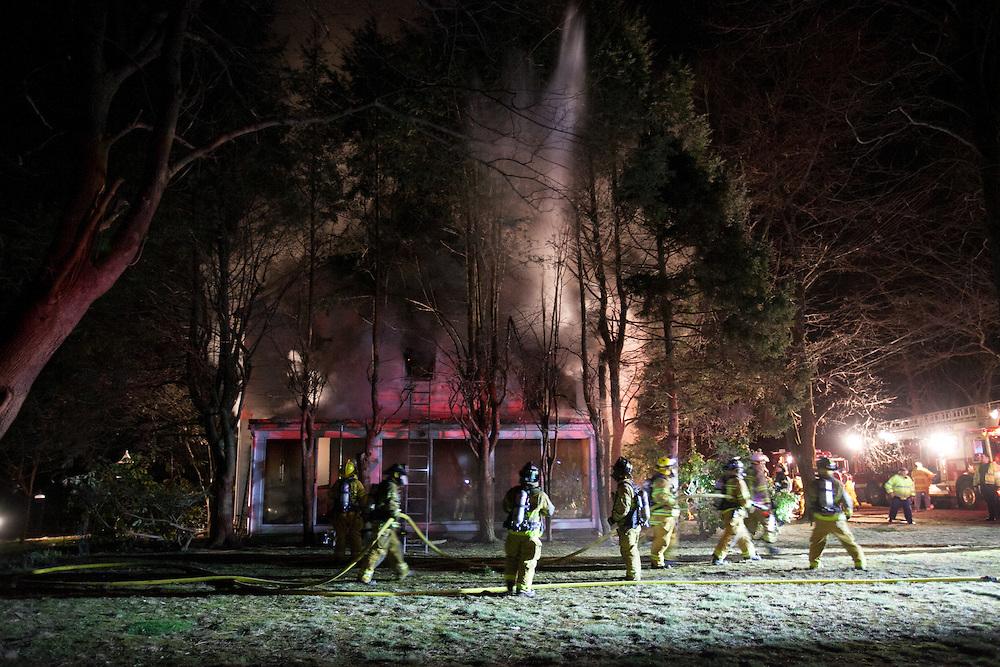 Sherborn, MA 04/11/2013<br /> Firefighters battle a 3 alarm house fire at 255 Western Ave. in Sherborn on Thursday night.<br /> Alex Jones / www.alexjonesphoto.com